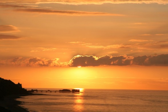 Sunset towards Cromer from Overstrand beach, north Norfolk
